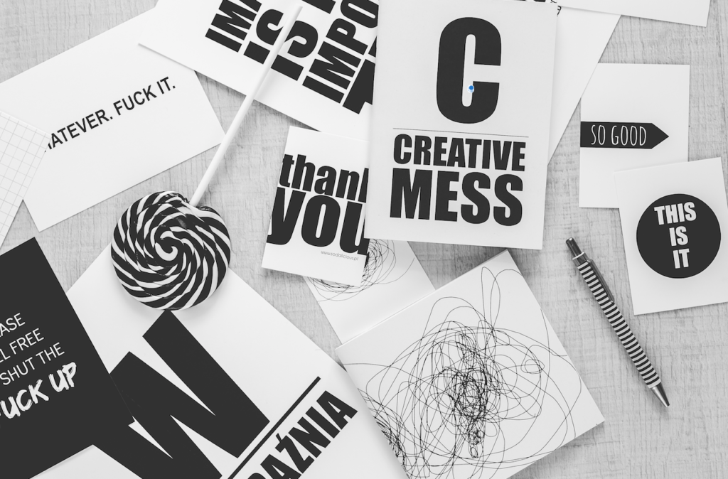 Top view of black and white typography that says get creative